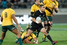 Aaron Smith was a handful for the Wallaby defence and is now playing better than Will Genia (left). Photo / Mark Mitchell