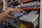 Should cigarettes be banned in dairies near schools? Photo / File