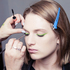 Model Ashleigh Good gets made up before the Karen Walker show, with M.A.C Chromaline on the eyes. Photo / Oliver Rose