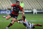 Ryan Crotty of Canterbury running with the ball in the tackle of Kylem O'Donnell of Waikato. Photo / Getty Images