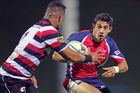 Bryce Heem of Tasman makes a run against Hika Elliot of Counties Manukau during the round three ITM Cup match. Photo / Getty Images