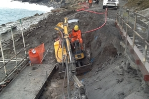 ON THE MEND: A drilling contractor installs rock anchors in existing bedrock at Cape Palliser so the new section of concrete will be held in place.PHOTO/DAVID HARGOOD