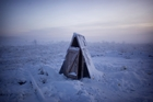 Toilet of the tundra. Two slats of wood above a spire of frozen poo. Photo / Amos Chapple