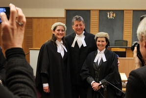 FAMILY LAW: Russell Fairbrother after being admitted to the Inner Bar yesterday, flanked by daughter Gretel (left) and wife Pam, also lawyers and both members of the Outer Bar. PHOTO/DUNCAN BROWN HBT133001-20