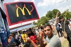 Danny Alvarez protests at a fast food restaurant in Austin, Texas as part of national strikes. Photo / AP