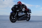 Kiwi Corey Bertelsen at the Salt Flats targeting land speed records with his 250cc bike and motorcycle with sidecar.
