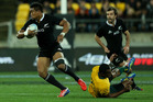 Julian Savea of New Zealand evades the tackle of Tevita Kuridrani of Australia. Photo / Getty Images