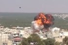 "The moment an aircraft allegedly dropped explosives onto the city of Idlib, Syria has been captured on camera. The video below, taken earlier today, shows an enormous explosion hitting an area near the region's reservoir. A series of loud bangs can be herd in the aftermath of the explosion. The source said that a helicopter had ""dropped 20"" explosive barrels above the area, causing the explosion. Credit: AENN/NewsPoint/NewsPoint"