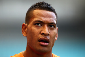 Code-hopping star Israel Folau is set to play for the Wallabies at the 2015 Rugby World Cup after signing a new two-year contract. Photo / Getty Images.