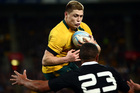 James O'Connor of Australia is tackled by Charles Piutau of the All Blacks. Photo / Getty Images