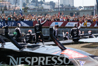 Emirates Team New Zealand wave to the crowd after victory in race 4 and 5 of the Louis Vuitton Cup Finals. Photo / Getty Images