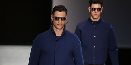 Models wear creations for Giorgio Armani men's Spring 2014 collection. Photo / AP