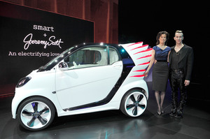 Dr Annette Winkler, head of Smart (left) with fashion designer Jeremy Scott unveiling the SmartForJeremy show car - a version of the new Smart Fortwo electric drive. Picture/Getty Images