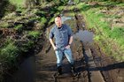 Arawa Rd resident Jason Fagan wants holes at the end of the road fixed. Photo / Andrew Warner