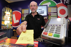 Bayfair Lotto co-owner Maurice Parker is bracing for a busy two days ahead of tomorrow night's Powerball draw. Photo / George Novak
