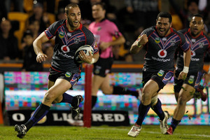 Warriors captain Simon Mannering cruises to the try line against the Raiders last night. Photo / Richard Robinson