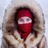 Husky-eyed girl at a bus stop in Yakutsk. Photo / Amos Chapple
