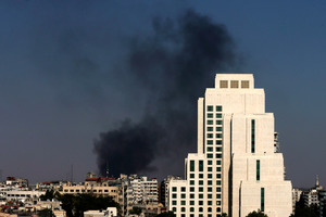 Black columns of smoke rise from heavy shelling in the Jobar neighbourhood in East of Damascus, Syria. Photo / AP