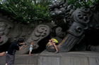 Graffiti referring to Bo Xilai's trial is evident on a stone tiger statue in a park in Jinan, in eastern Shandong province. It reads: