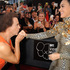Fitness guru Richard Simmons, left, kisses the hand of singer Katy Perry at the MTV Video Music Awards. Photo / AP