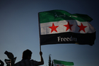 A Syrian protester waves the Syrian revolutionary flag. Photo / AP