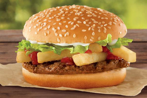 "This undated photo provided by Burger King shows a a ""French Fry Burger,"" which Burger King is rolling out for $1 as the company looks to fend off a Dollar Menu push by McDonald's. (AP"