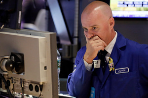 Specialist John O'Hara works at his post on the floor of the New York Stock Exchange. Photo / AP