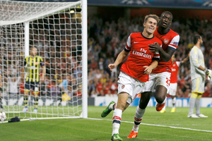 Arsenal's Aaron Ramsey, left, celebrates his second goal against Fenerbahce with teammate Yaya Sanogo during their Champions League qualifying play-off second leg soccer match. Photo / AP