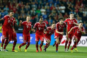 Munich players celebrate after winning the soccer Super Cup final between Champions League winner Bayern Munich and Europa League winner Chelsea FC at the Eden Stadium. Photo / AP.