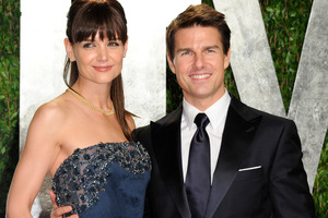 The daughter of Tom Cruise and Katie Holmes has broken her arm.Photo / AP
