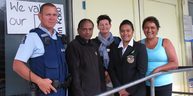 Whangaroa College student Charlotte Morunga, second from right, succeeded in her efforts to ban liquor on Kaeo's main street. Joining her are Kaeo police community Constable Richard Avery, Four Square owner Hitendra Patel, Allie Avery, and Helen Foley.
