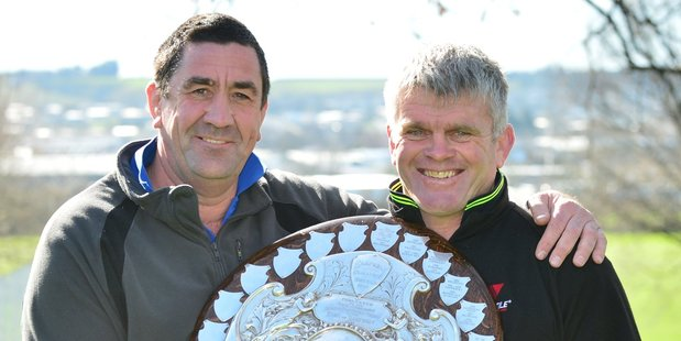 Former Otago players Richard Knight and David Latta proudly carry the hard-earned Ranfurly Shield. Photo / Peter McIntosh