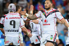 Feleti Mateo of the Warriors celebrates a Try by Jerome Ropati during the round 24 NRL match between the Gold Coast Titans and the New Zealand Warriors. Photo / Getty Images.