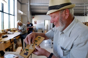 MALE DOMAIN: Glyn Saunders remakes a lost kindergarten puzzle piece at the Masterton Henley Men's Shed, which the Greytown Men's Shed group plans to emulate. PHOTO/APN