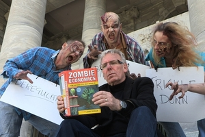Documentary maker Bryan Bruce surrounded by zombies - Mind The Gap.