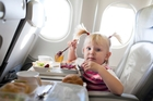 Air NZ says children are welcome in any cabin, but parents can sit in another class with their children travelling as unaccompanied minors. Photo / Getty Images