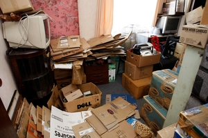 Some of the tenants belongs are in cardboard boxes stacked in a bedroom Photo / JOHN STONE