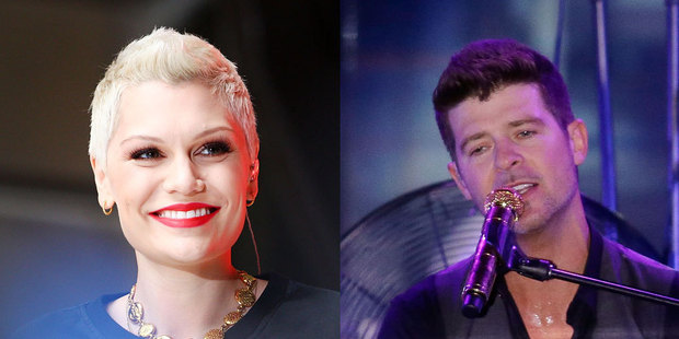 Jessie J, left, says she won't be quick to take her clothes off in the video for her 'Calling All Hearts' collaboration with Robin Thicke. Photos / Getty Images