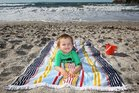 Jasper Robertson 2yrs enjoys the mild tempartures at the Mount Beach. Photo/John Borren