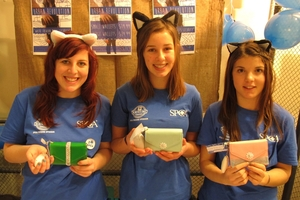 ALARMING: Whangarei Girls' High company Urban Revolution makes wallets with a security alarm. Brianna Tancred-Whitham, 16, Susan Turney, 16, and Sarah Harkness, 16, all of Whangarei. Their profits went to the SPCA.