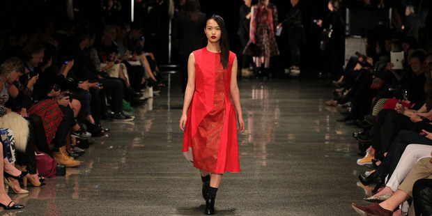 Model Seon walks the runway at Zambesi's NZ Fashion Week show, which featured an exposed backstage. Photo / Getty Images