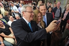 Prime Minister Kevin Rudd and Opposition leader Tony Abbott are keen to woo voters. Photo / AP