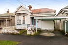 This tired Grey Lynn villa sold for $1.2 million.