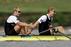 Eric Murray and Hamish Bond congratulate each other after winning the men's pair final at the world rowing championships. Photo / Getty Images