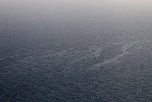 An aerial picture shows a vast liquid hydrocarbons spill off the western coast of Corsica. Photo / AFP