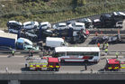 An aerial view showing emergency services attending the scene and some of the vehicles involved in a major accident on the Sheppey Bridge Crossing near Sheerness in Kent, south England. Photo / AP