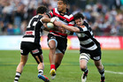 Rey Lee-Lo of Counties Manukau is tackled by Richard Buckman (R) and Zac Guildford of Hawke's Bay during the round four ITM Cup Ranfurly Shield match. Photo / Getty Images.