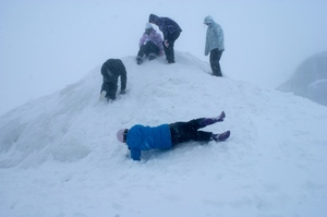 College kids get out amongst the snow after getting trapped on Mt Hutt. Photo / Georgie Boyd