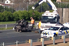 One of the cars involved in an accident on the Southern motorway after a bank robbery in Pukekohe. Photo / Richard Robinson