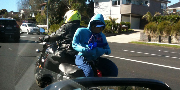 "Thomas noticed this motorcyclist who had a clothed stuffed dummy strapped to the back of his bike. ""Maybe it was to trick the transit lane rule?"" he says."